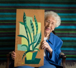 Photo of Suzanne with one of her paintings