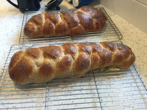 Pair of four-braid honey whole wheat challahs fresh from oven